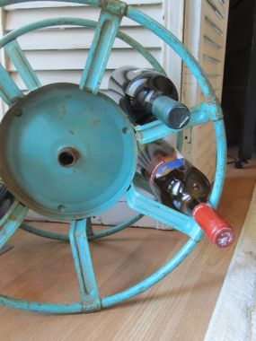 This vintage hose reel gets a new live as a wine rack - a brilliant and easy thrift store DIY project