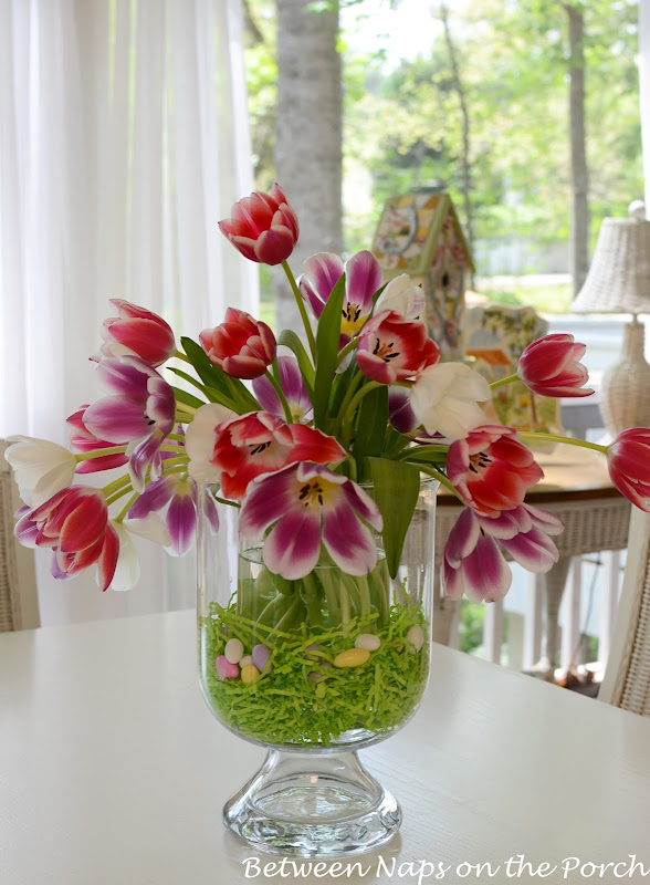 This gorgeous floral centerpiece bouquet is held in a crystal hurricane vase