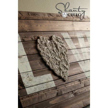 LOVE this DIY pallet wall art from Shanty 2 Chic with a simple message and crafty rose swirl heart