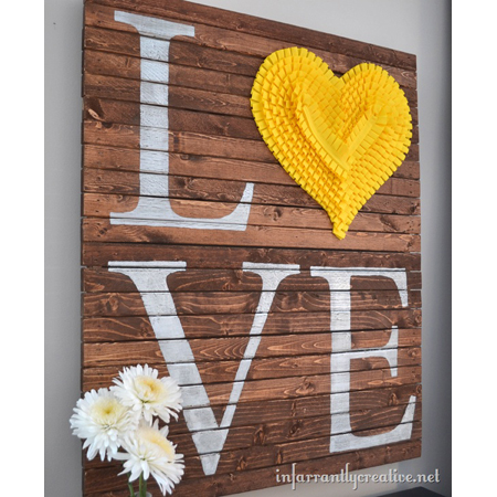 Infarrantly Creative created this large pallet wall art is a beautiful spring art piece.