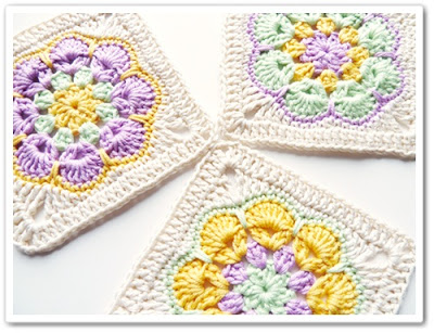 These simple crocheted granny squares made with similar colors are bright and cohesive.