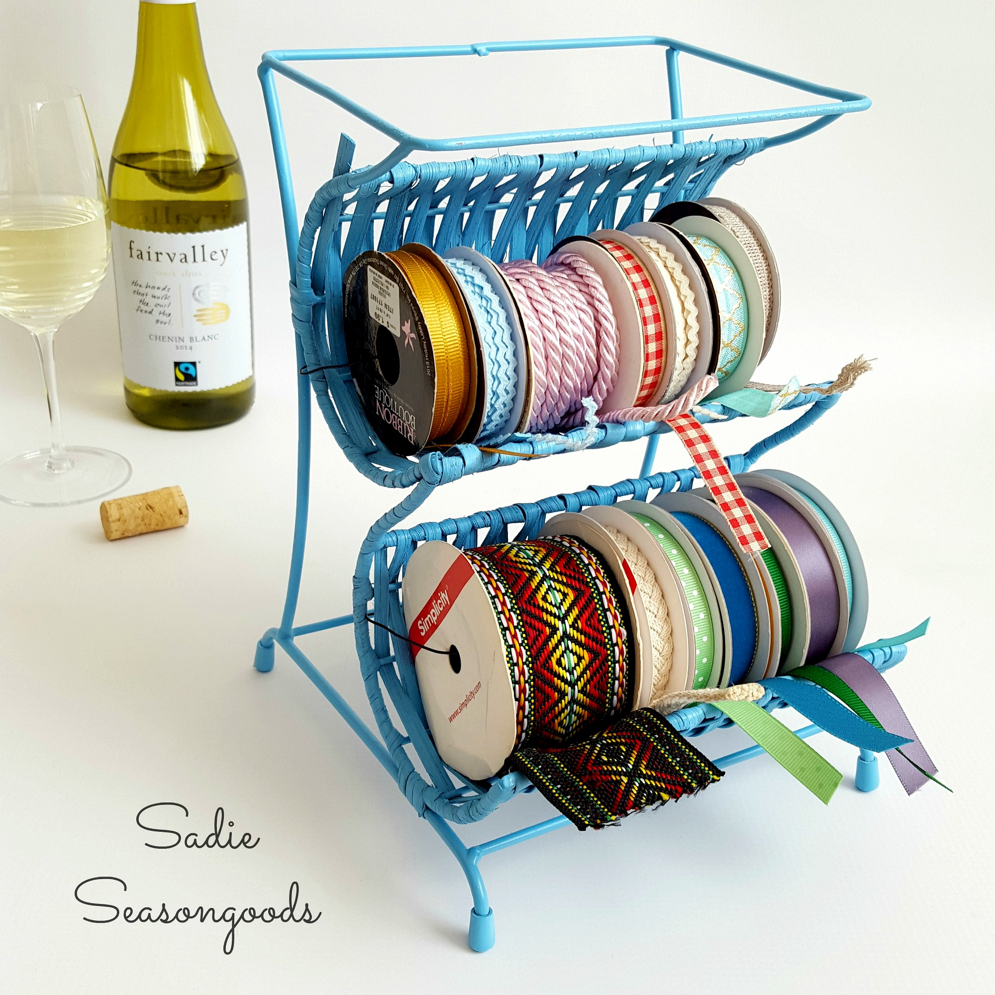 Wine_bottle_holder_repurposed_into_craft_ribbon_cradle_holder_Sadie_Seasongoods