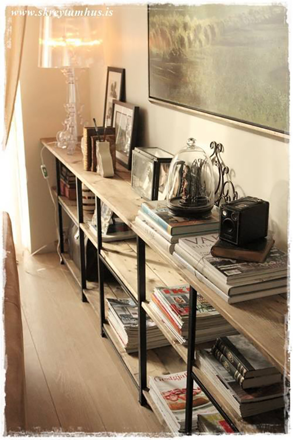 A few IKEA shelves put together makes this industrial style wall-length storage