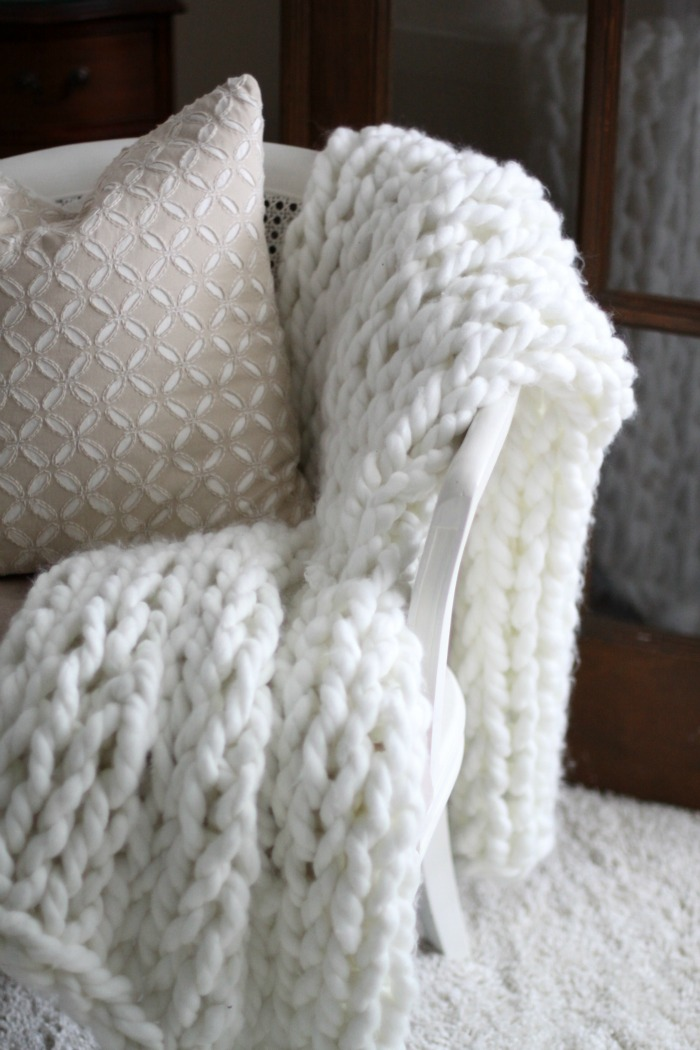 You don't need knitting needles for this knit blanket, just your arms and some spare time!