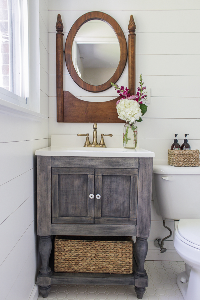 This distressed bathroom vanity adds a rustic element to the space.