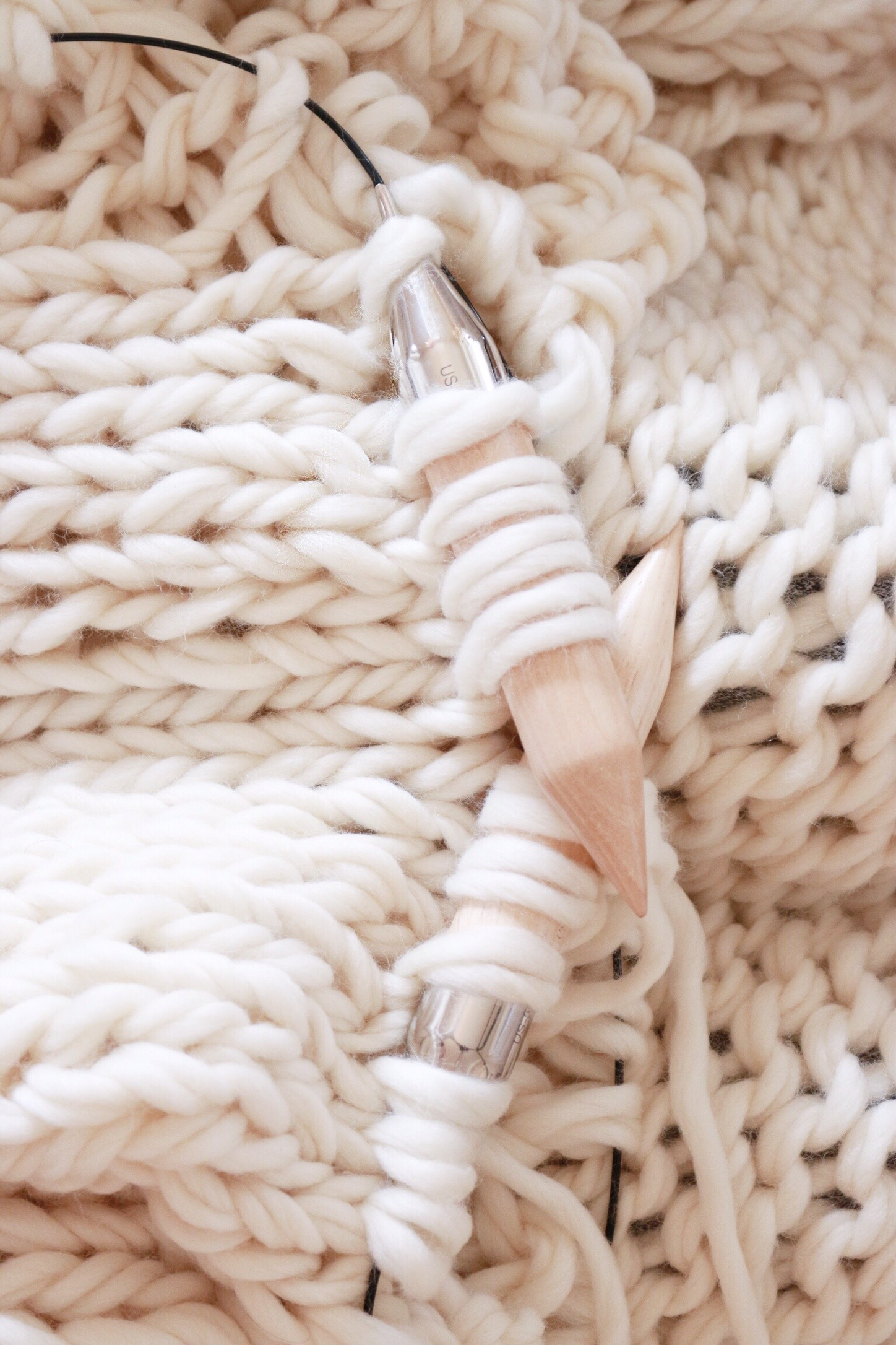 This intricate knitting pattern isn't hard to master after some practice, and worth it when you complete this cozy throw blanket