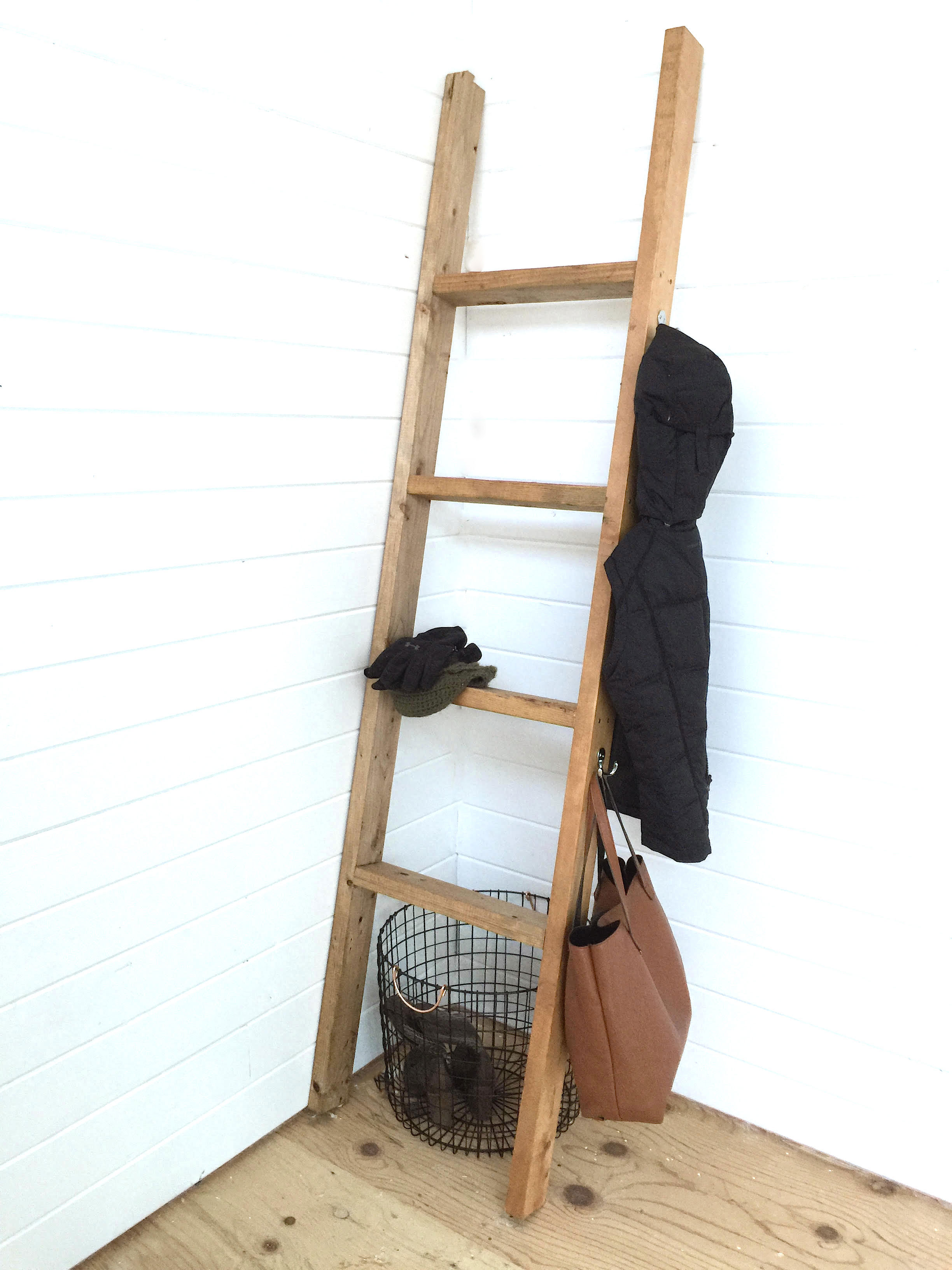 A decorative farmhouse style ladder that doubles as a coat rack? Functional and fabulous!