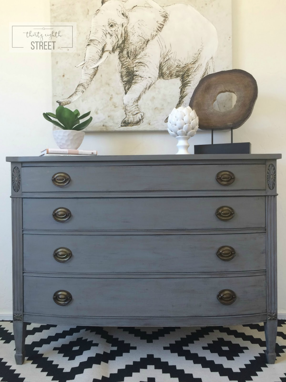 This refurbished wooden dresser with metal handles is rustic and modern.