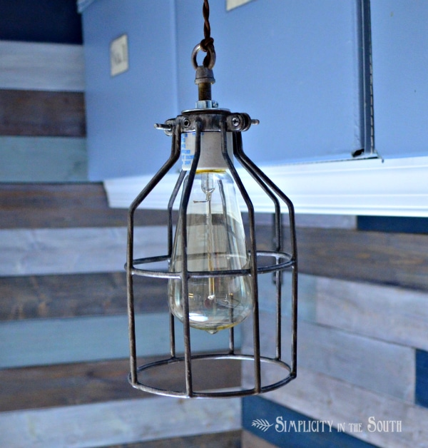 This industrial pendant lite compliments the wood walls.