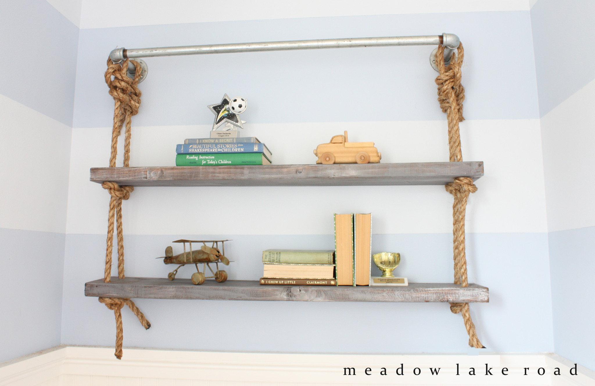 These shelves hung by a metal fishing rod are unique and mix farmhouse with industrial.