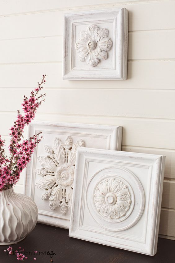 These carved pieces of wall art add the perfect farmhouse element to any space.
