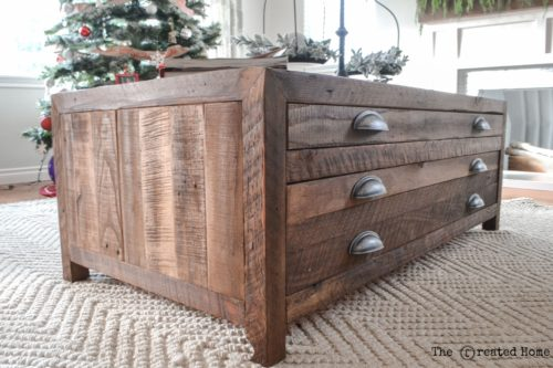 This renovated wooden coffee table is rustic and farmhouse looking.