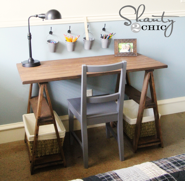 This simple wooden desk compliments the gray chair.