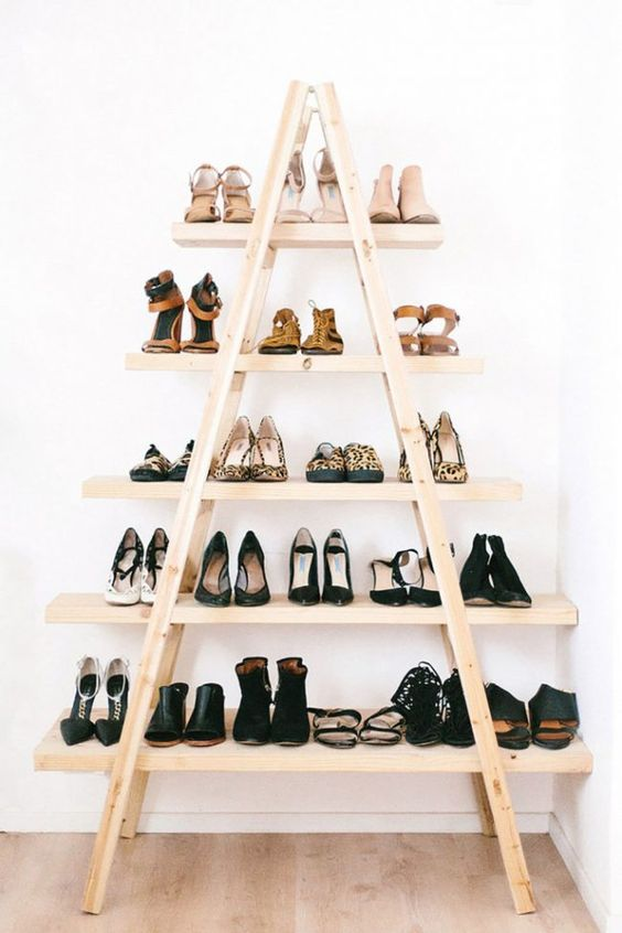 this diy shoe rack on casters is wonderful for any space in the home add a little paint or stain for a bit more of the farmhouse touch