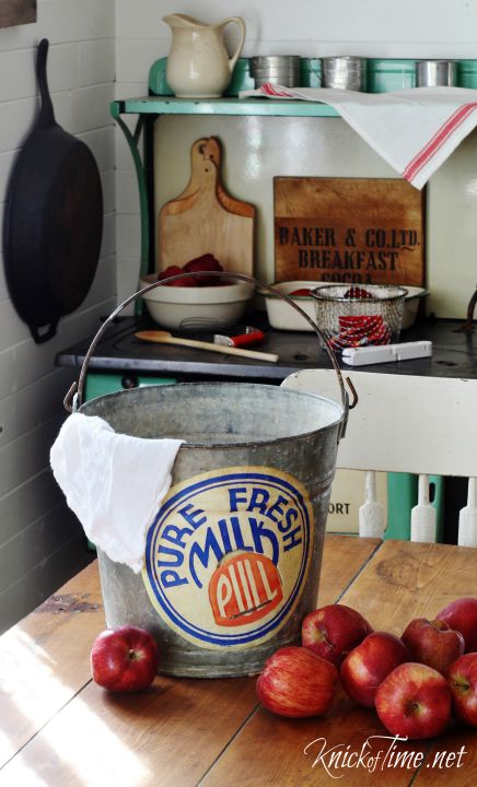 This thrift store pail is vintage looking and adds a cute rustic element to this kitchen.