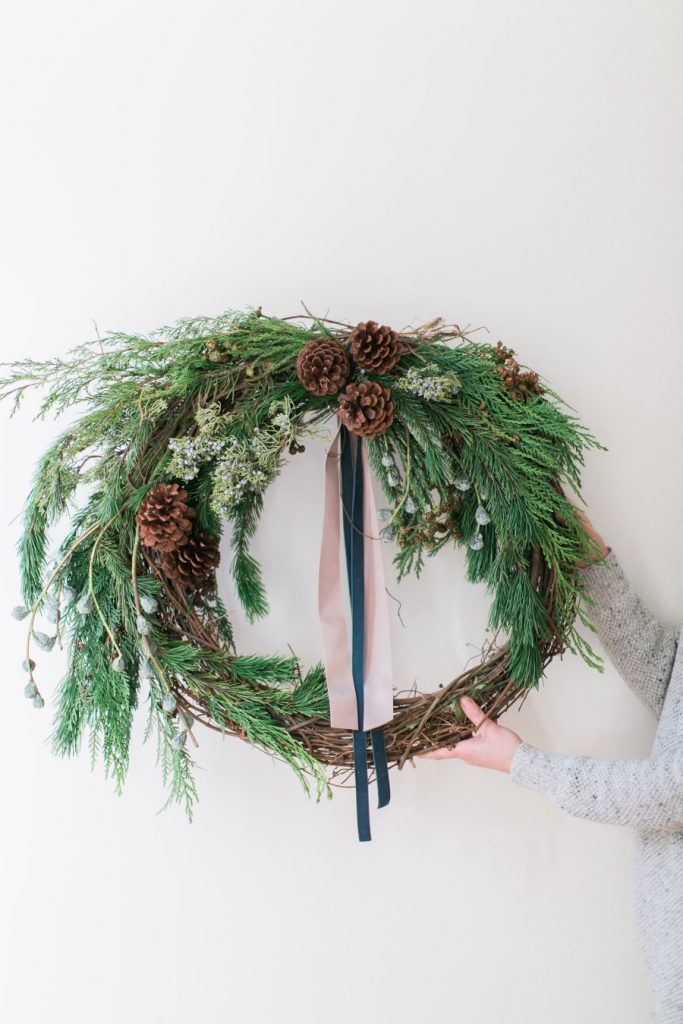 Let's explore this fabulous Collection of Perfect DIY Farmhouse Christmas Wreaths.  Each one is unique, beautiful and has tons of Farmhouse Charm. You might have a problem choosing.