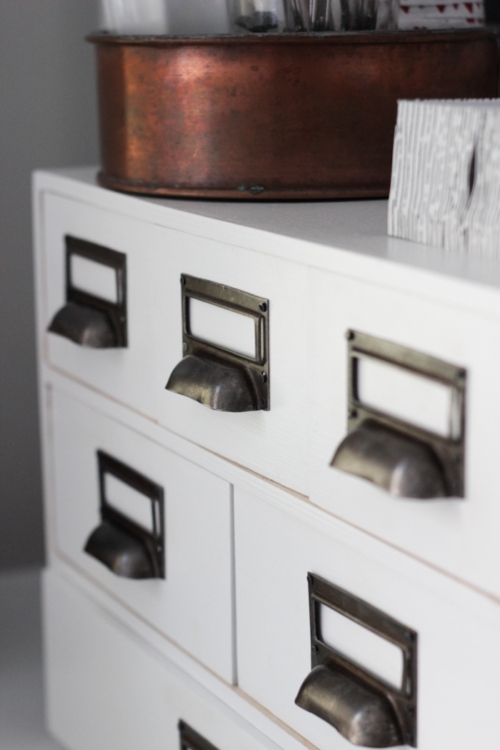 Classic office handle hardware gave this IKEA moppe unit a vintage look