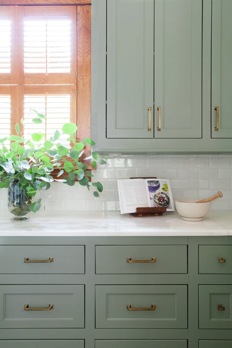 White Kitchen Cabinets With Teal Painted Backsplash