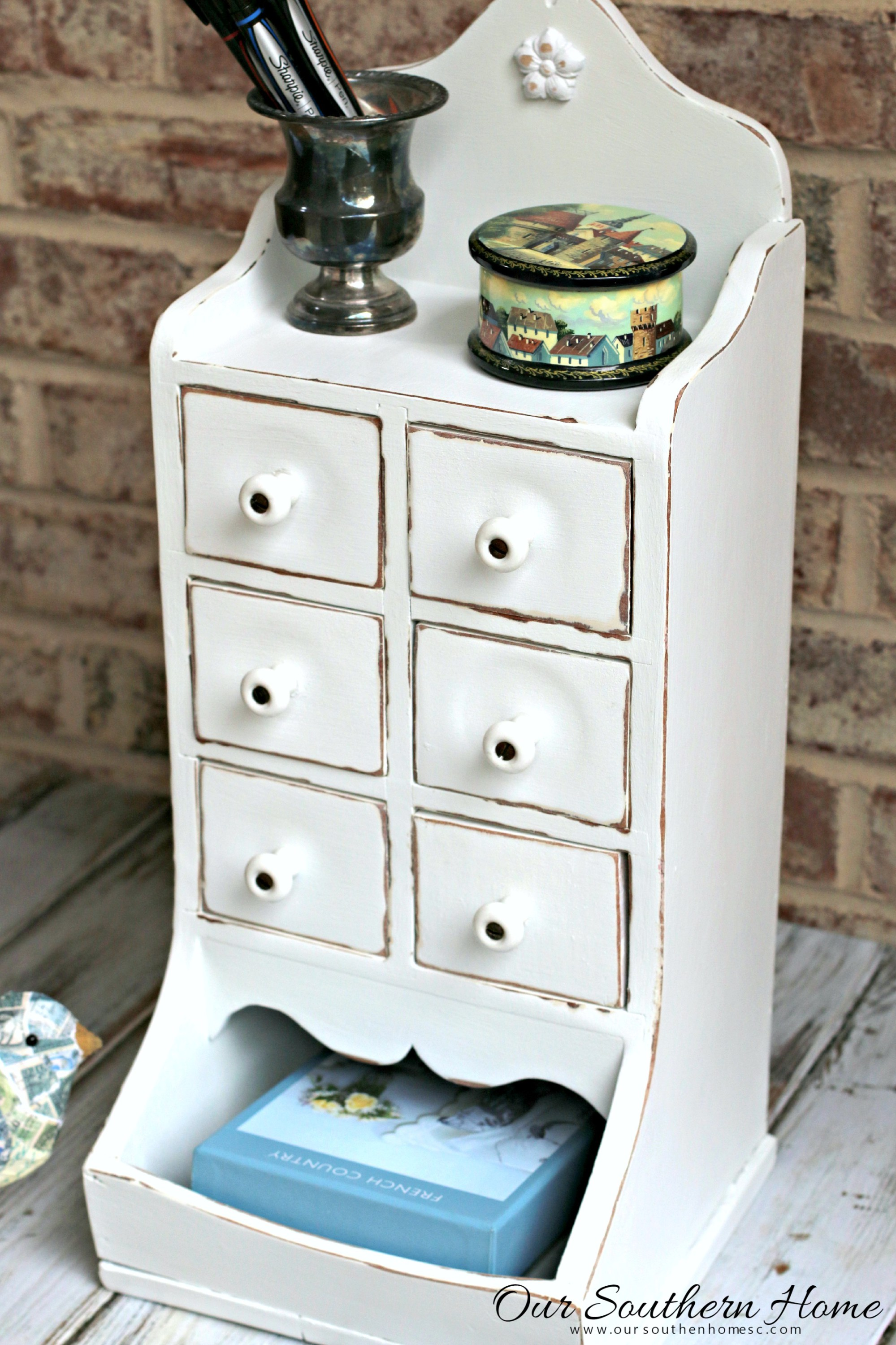 This cute white jewelry drawer is rustic and vintage.