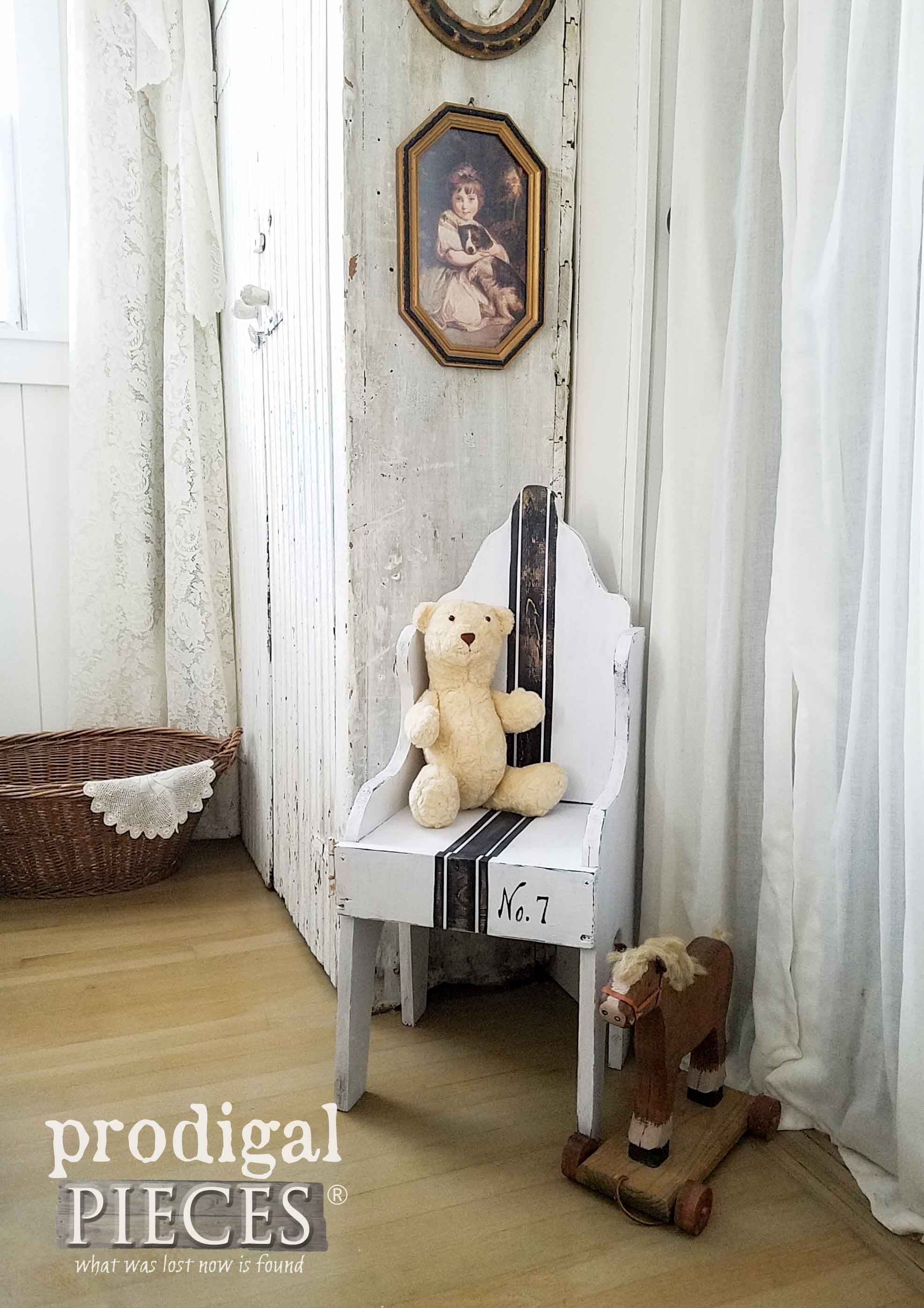 The distressed paint, rustic chair and classic drapes create a vintage space.