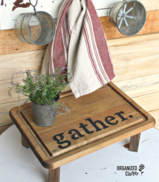 This adorable cutting board with a pot of fresh herbs on top is farmhouse.