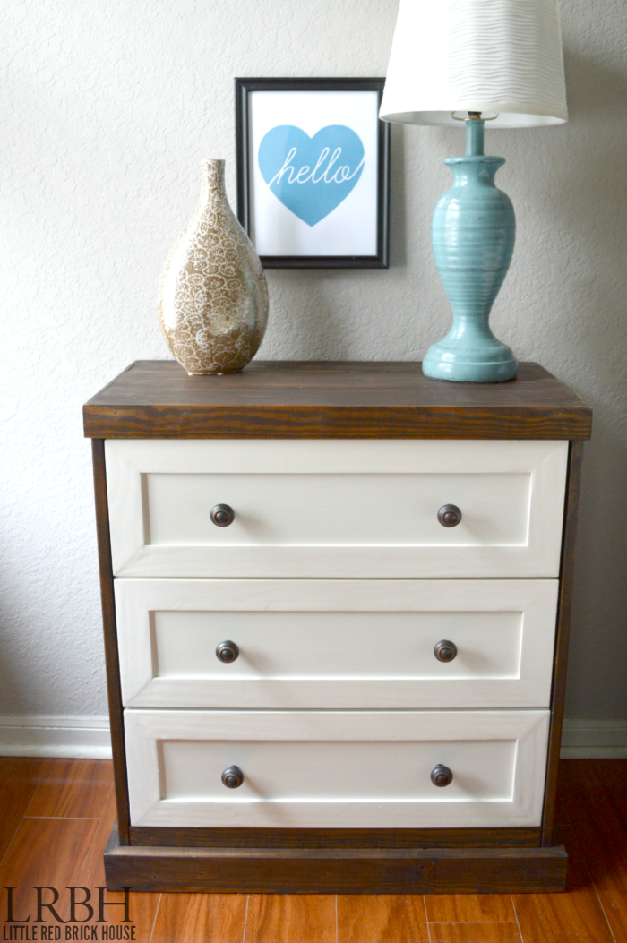 The combination of stained wood and white on this nightstand is beautiful.