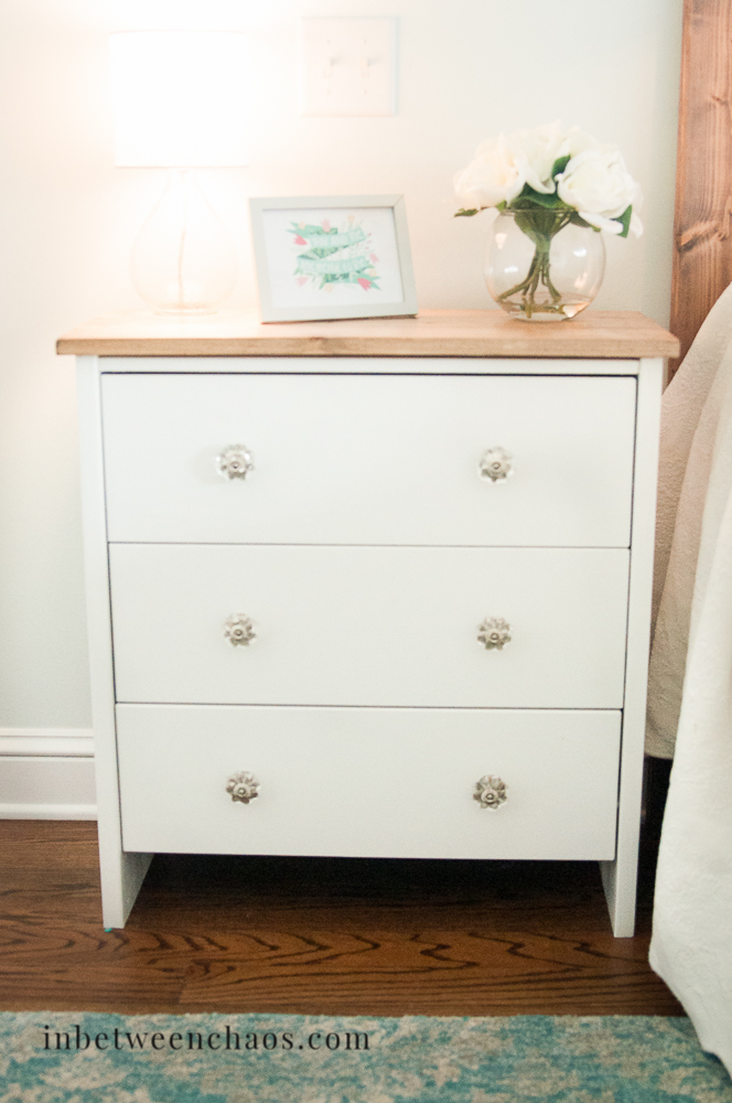 This simple white nightstand is a classic farmhouse style touch.