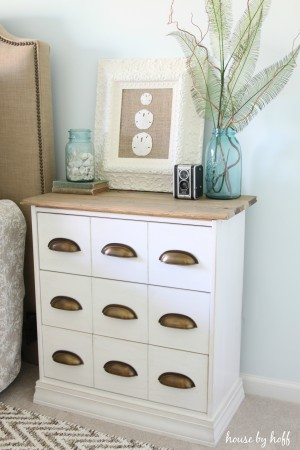 This coastal inspired bedside table compliments the light blue walls.