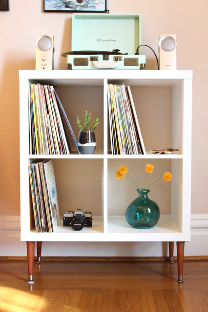This IKEA Kallas shelving unit makes the perfect house for your records and record player with the cubed spaces and sleek design