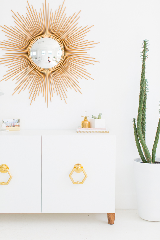 This IKEA cabinet is stunning with large golden handles that make a bold statement