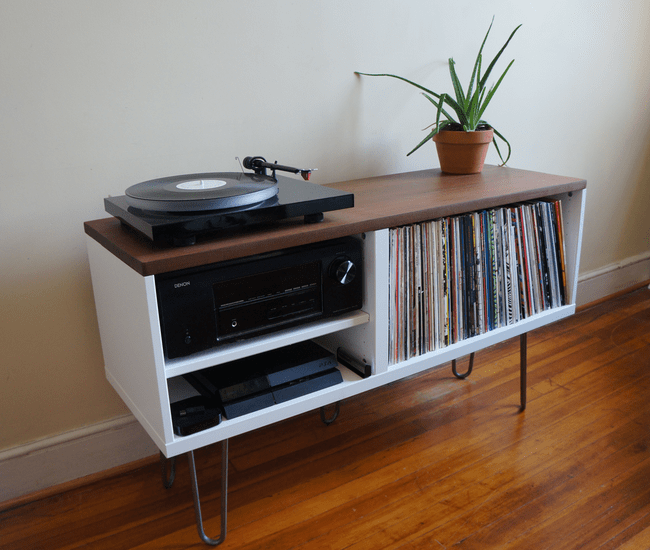 This IKEA BESTA is a perfect home for records and a record player in your living room. A simple modern design mixed with vintage tech!