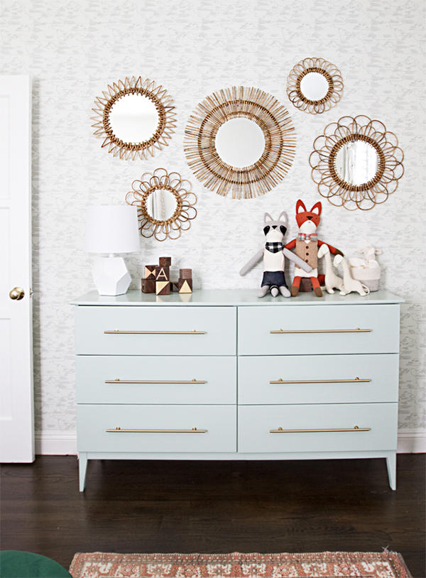 This gorgeous dresser has so many amazing new elements like brand new legs, a fresh coat of paint, and gold hardware