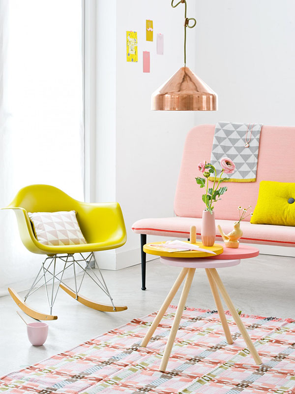 Pick up some IKEA FROSTAs and some paint to make this mid century modern side table