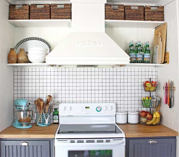 THIS quaint cooking space has great storage, and that tile backsplash is simple and stunning!
