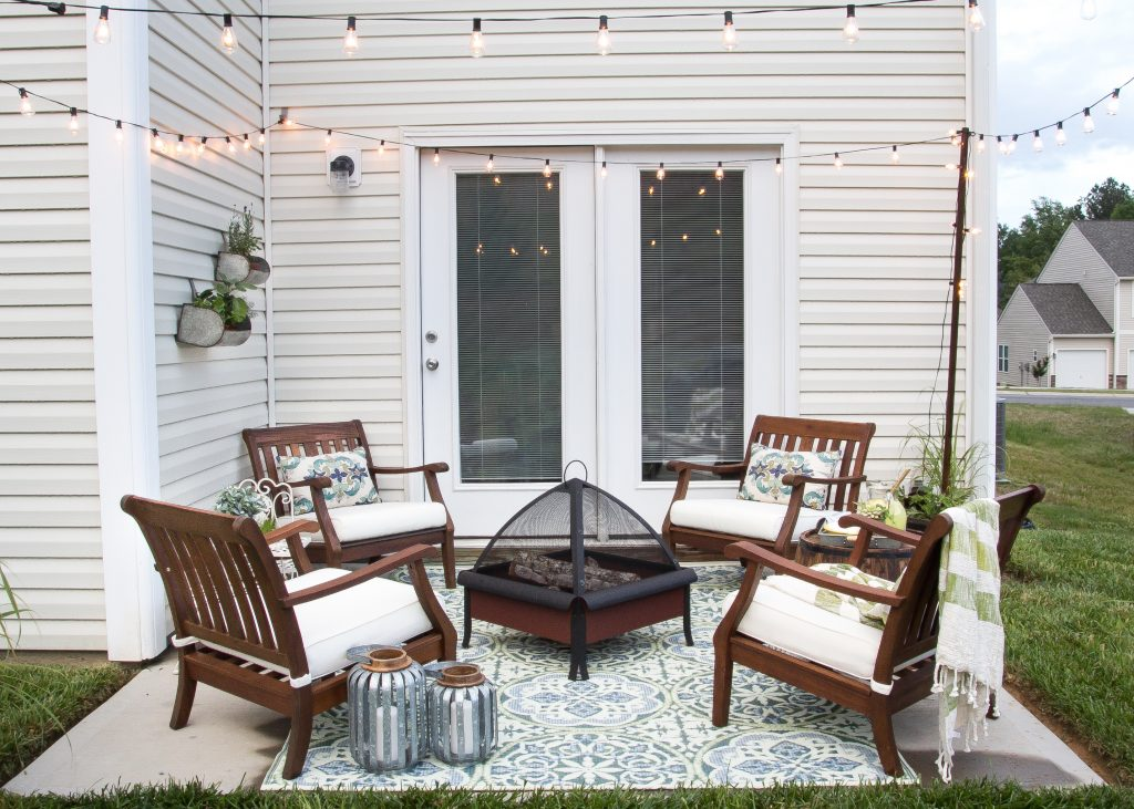 This small patio space is comfortable and welcoming with a small fire pit and adirondack chairs