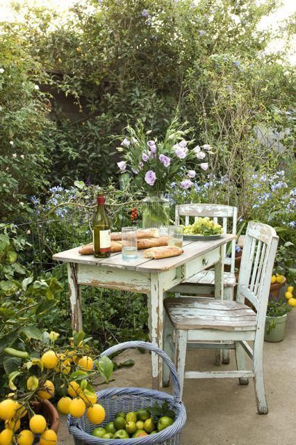 This small patio has a perfect picnic spot with this farmhouse style table and chairs