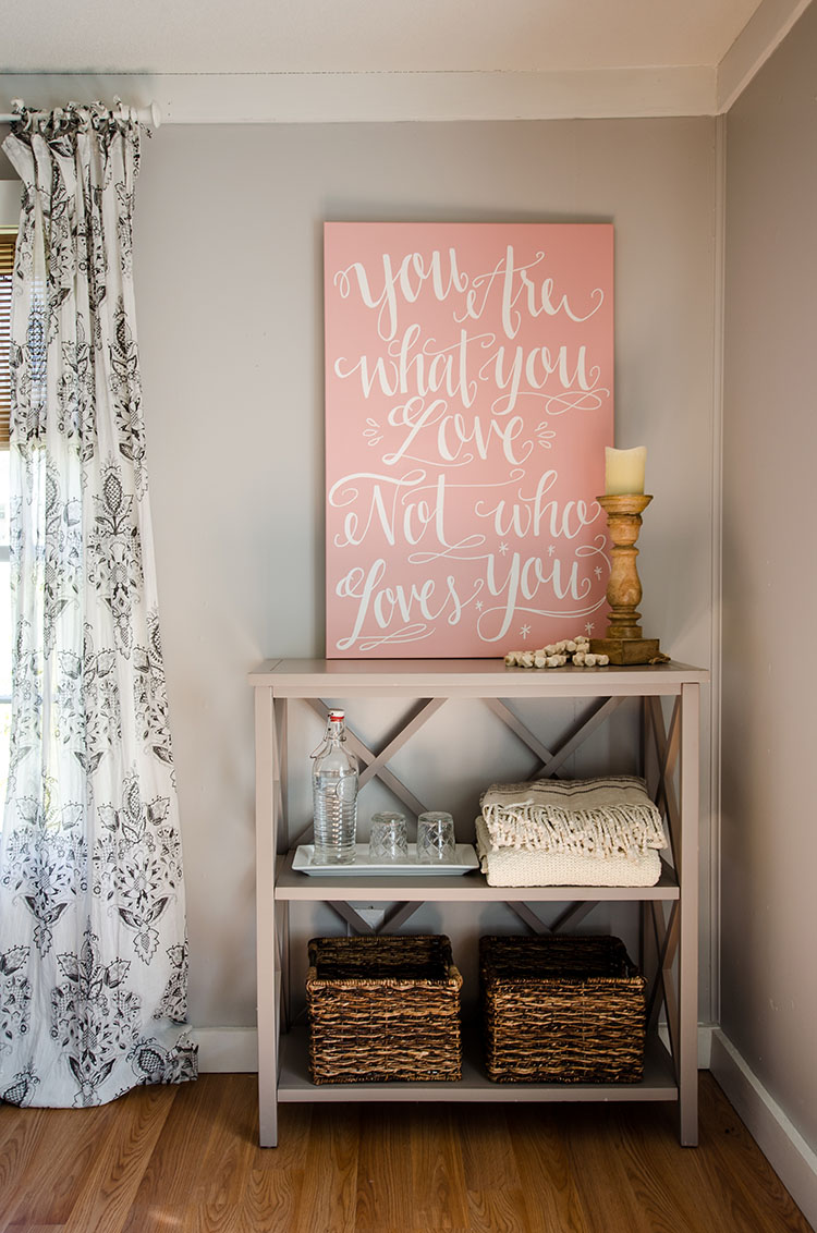 Inspirational wall art is a farmhouse touch that adds a little color to this corner of the cottage