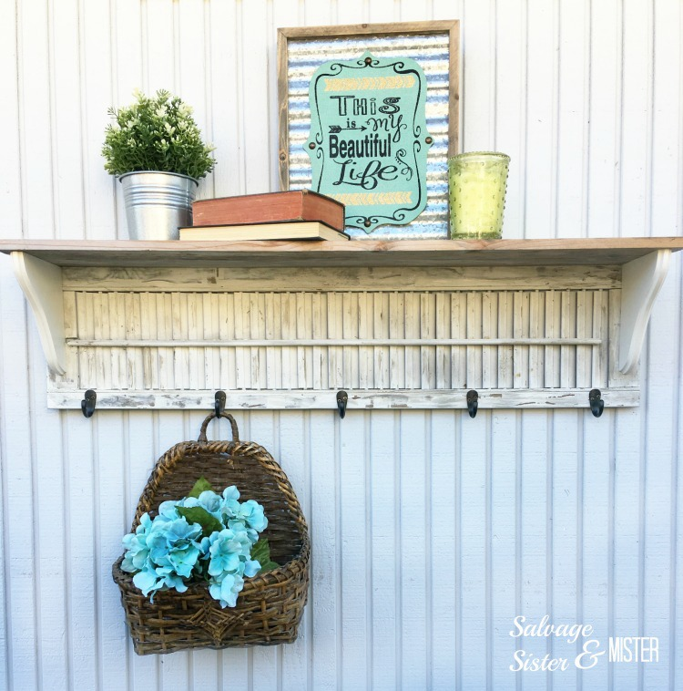 This rustic shelf is perfect for hanging things and displaying decor.