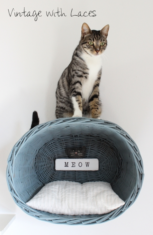 This vintage basket with a cat detail is adorable and unique.