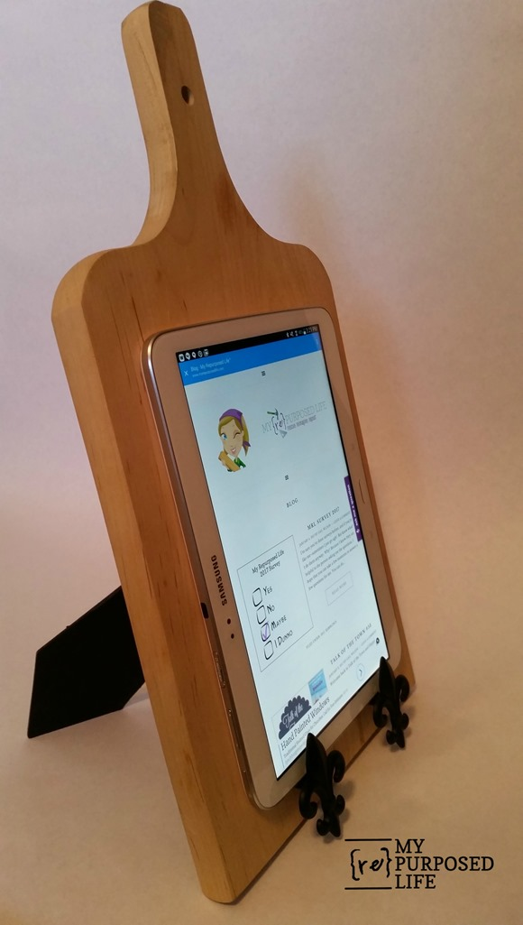 This wood cutting board is perfect for holding an iPad in the kitchen.