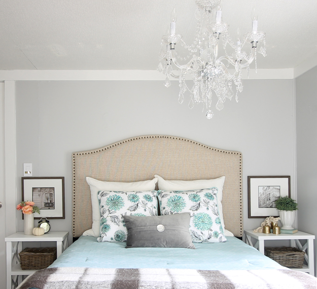 The Shabby Creek Cottage master bedroom is bright and colorful but cozy - that chandelier is stunning!