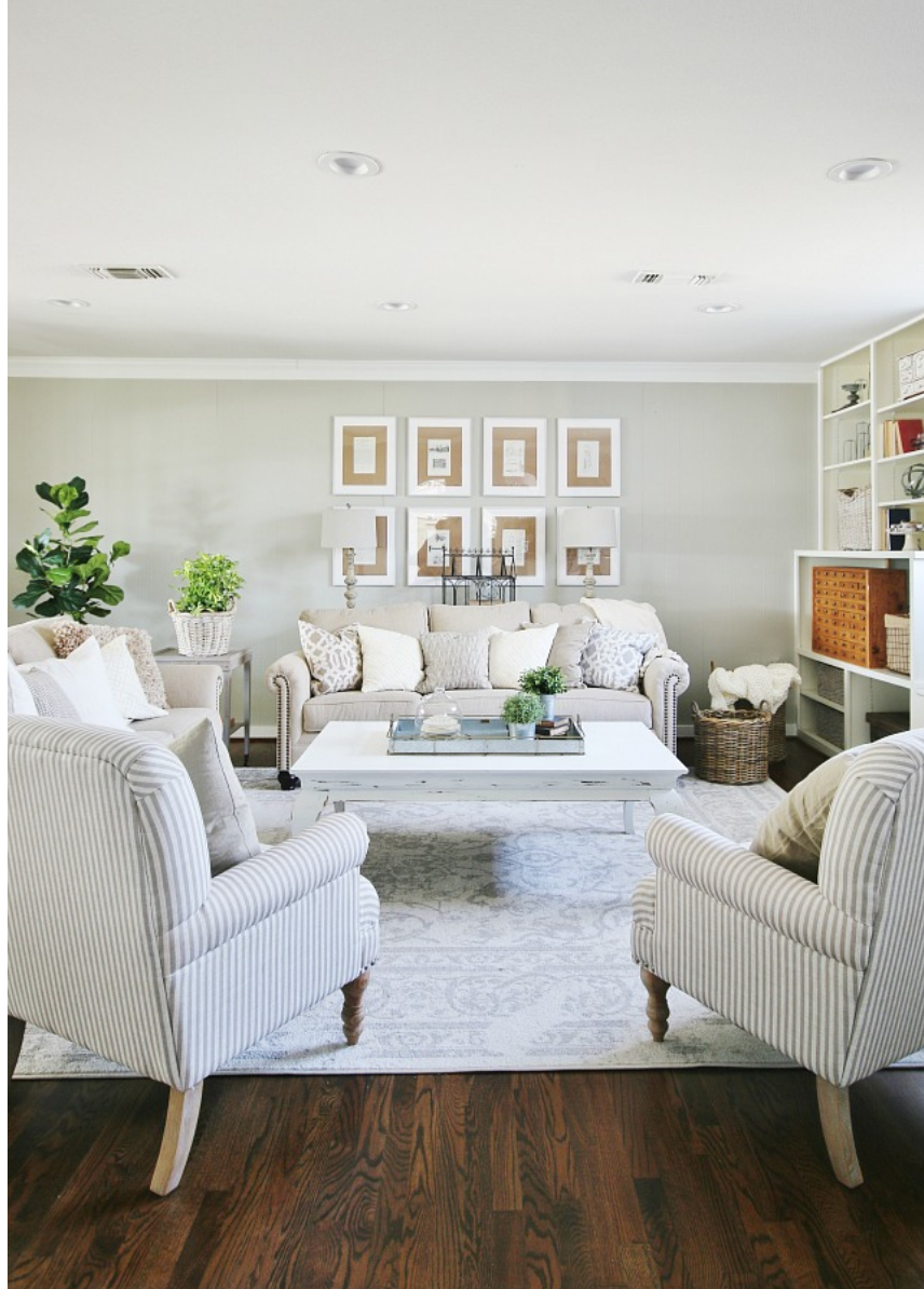 The various accent pillows in this cozy living room compliment the wood floors.