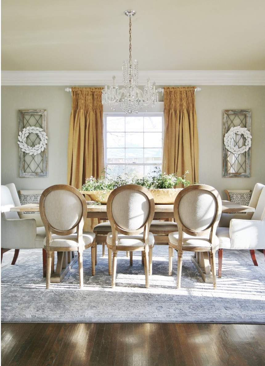 This charming dining room is light and the perfect balance of farmhouse chic.