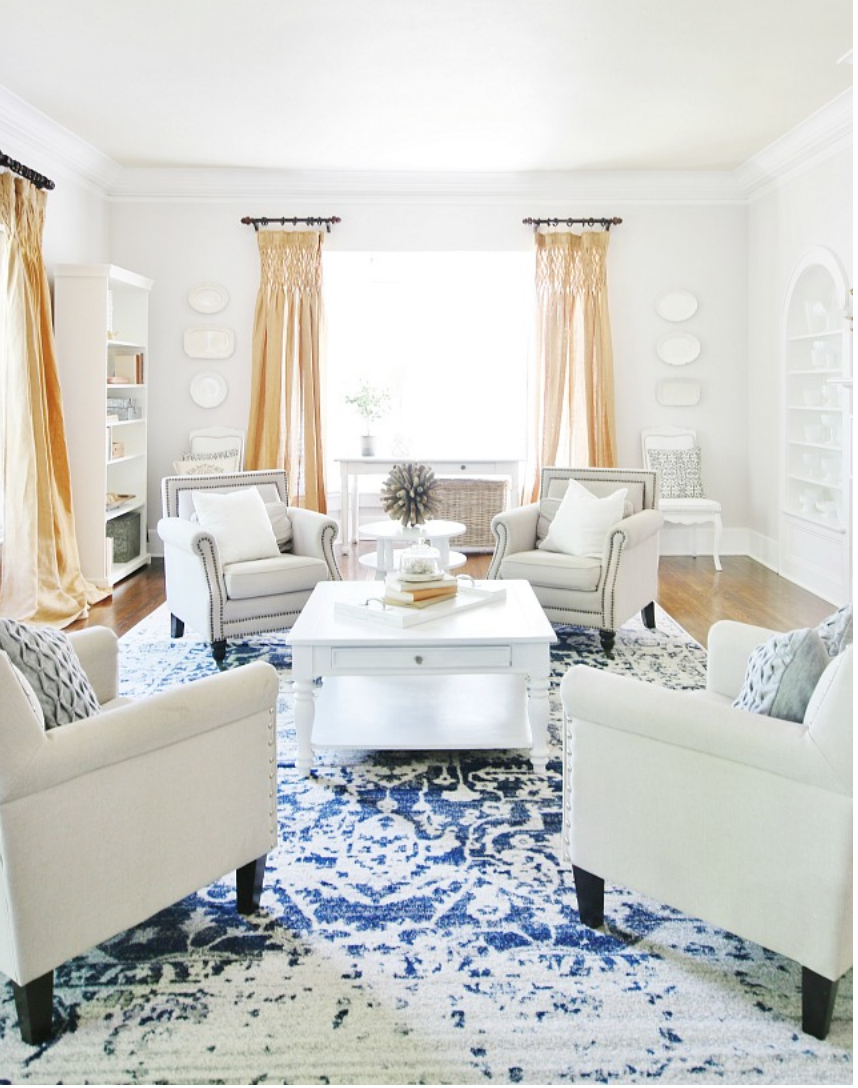 These bright mustard yellow drapes compliment the blue hues in the rug.