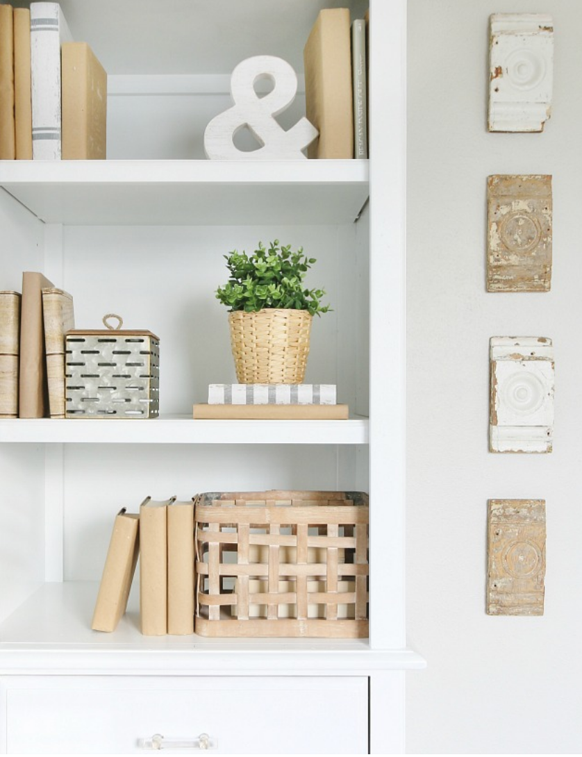 The detailed decor pieces in these shelves from plants to books are chic.