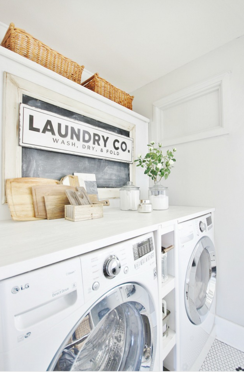 This laundry room is bright, clean and minimalistic.