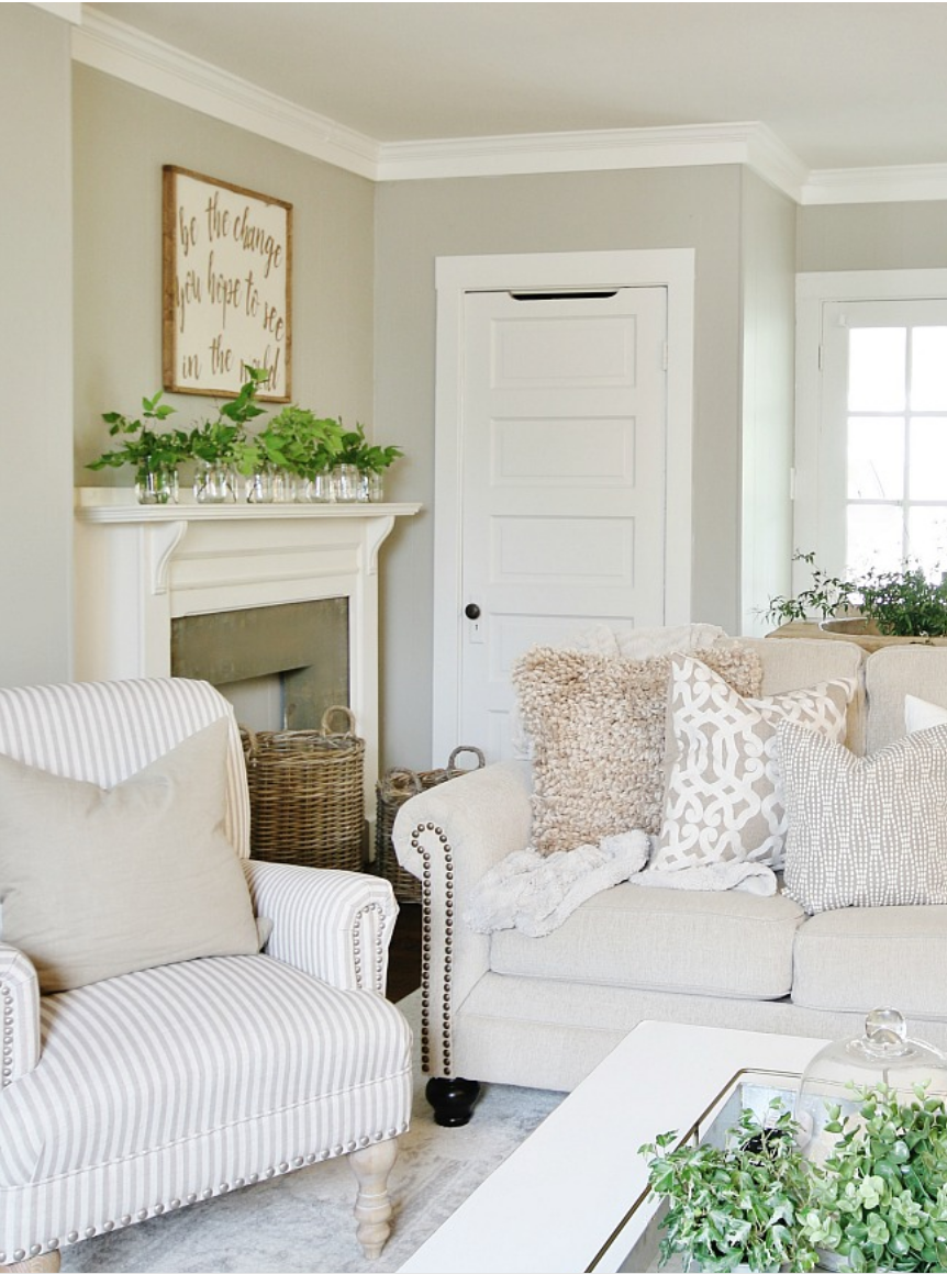 The various plants on the white fireplace mantel add interest to the space.