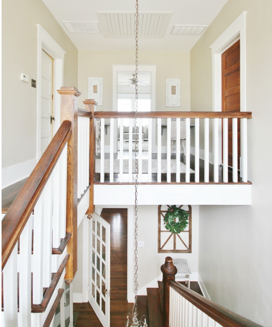 This long hanging chandelier adds drama to this quaint farmhouse.