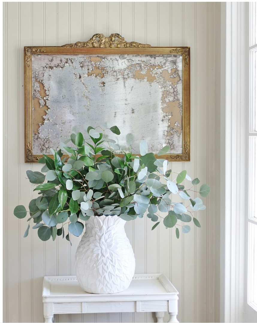 This gold vintage hanging mirror adds a rustic touch to the farmhouse.