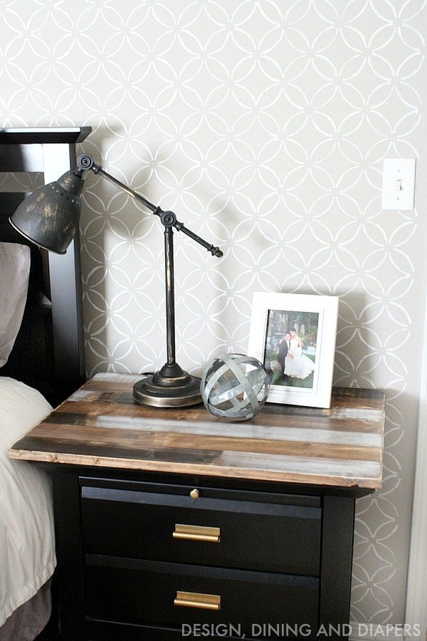 A rustic, weathered stain and black paint gives this IKEA side table a slick yet rustic farmhouse style